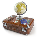 Travel or tourism concept. Old suitcase with stickers, globe and Royalty Free Stock Photo