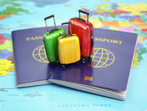 Travel or tourism concept. Passport and suitcases on the world m. Ap. 3d Royalty Free Stock Photography