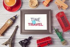 Travel and tourism concept with photo frame and souvenirs from around the world. View from above. Flat lay royalty free stock images
