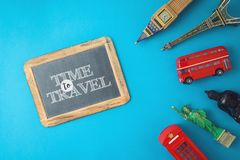 Travel and tourism concept with souvenirs from around the world on blue  background royalty free stock photos