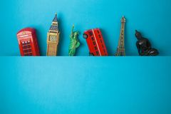 Travel and tourism concept with souvenirs from around the world on blue  background royalty free stock photo