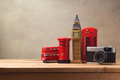 Travel and tourism concept with souvenirs from London and vintage camera on wooden table Royalty Free Stock Image