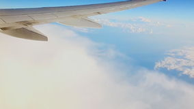 Travel, Tourism, Destination Concept. Wing of an Airplane Flying Above the Clouds in Blue Sky. HD stock video footage