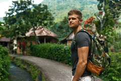 Travel And Tourism. Healthy Tourist Man In Forest In Summer. Travel And Tourism. Tourist Man Adventure On Summer Vacation. Beautiful Handsome Free Happy Royalty Free Stock Photography