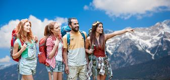 Group of friends with backpacks over mountains Stock Photography