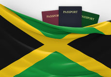 Travel and tourism in Jamaica, with assorted passports Royalty Free Stock Images