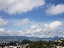 Sunny day with blue sky and white clouds in the Toluca valley. Travel and tourism, located in the State of Mexico, urban landscape stock photography