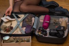 Travel, tourism and objects concept - close up of woman packing travel bag for vacation stock photos