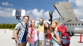 Friends taking selfie by smartphone on airfield stock image