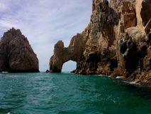 Traditional arch of Los Cabos. Travel, tourism, sea, rocks, nature, natural, sky, clouds, waves, vacation, Baja California Sur, Mexico Royalty Free Stock Photo