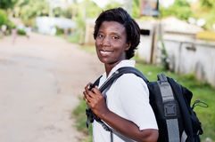 Smiling young woman with backpack. Travel, tourism - smiling young woman with backpack ready to hit the road Stock Image