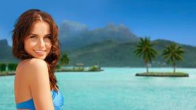 Happy woman in bikini swimsuit on bora bora beach Stock Image