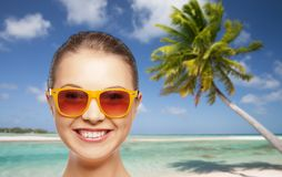 Happy woman or teenage girl in sunglasses on beach royalty free stock photography