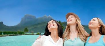 Happy women over bora bora background Royalty Free Stock Photos