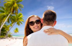 Happy couple hugging over tropical beach Royalty Free Stock Images