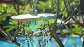 Travel, tourism, vacation and summer holidays concept. Turning on an outdoor shower with fresh water in slow motion. 1920x1080 stock video footage
