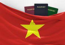 Travel and tourism in Vietnam, with assorted passports. 3D rendered concept for travel and tourism in Vietnam, with three assorted passports Royalty Free Stock Images