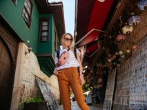 Travel tourist girl exploring old streets of Europe city. With backpack royalty free stock images