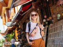 Travel tourist girl exploring old streets of Europe city. With backpack stock photo