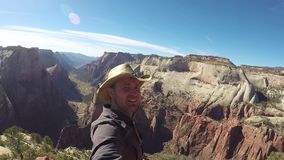 Travel Tourist Man Taking Selfie Video Hiking In Zion Park Mountains Canyon. Utah, USA. He smiling and enjoy amazing views. Slow motion, hd, 1980x1080 stock video