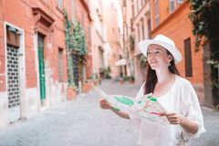 Travel tourist woman with map in Prague outdoors during holidays in Europe. Tourist young woman with a city map on italian old street in Europe. Travel tourist royalty free stock images