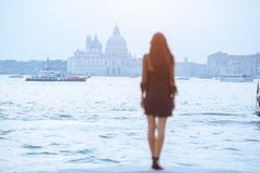 Travel tourist woman on pier against beautiful view on venetian chanal in Venice, Italy. stock photography