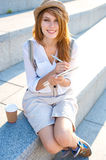 Travel tourist woman taking notes in a copybook Royalty Free Stock Images