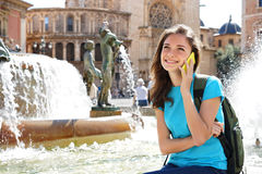 Travel tourist woman talking on smartphone and smiling in Valencia, Spain Royalty Free Stock Photography