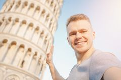 Travel tourists Man making selfie in front of leaning tower Pisa, Italy stock photos