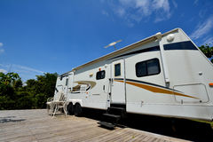 Travel trailer in camp Stock Photo