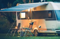 Travel Trailer Caravaning. RV Park Camping at Night royalty free stock images