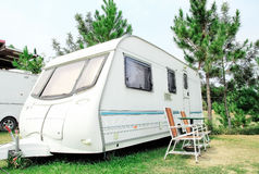 Travel Trailer with chair in the nature Royalty Free Stock Image