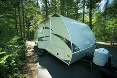Travel Trailer in RV Park. Recreation Vehicle in the Cascades National Park RV and Camping Area. Washington State, USA. Recreation Collection Royalty Free Stock Image