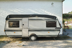 Travel trailer beside the wall Stock Photography