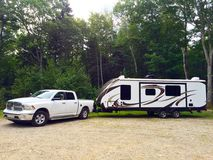 Travel trailer with white pick up truck rest Stock Photos