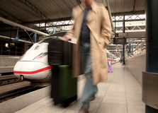 Travel. By train concept with man rushing in train station Royalty Free Stock Photography
