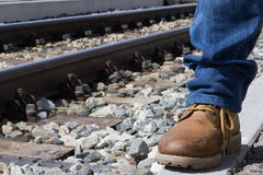 Travel by train. Walking along the tracks and take a trip by train Royalty Free Stock Photo