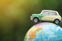 Travel and transport concept, car on world map balloon with green nature background. royalty free stock photography
