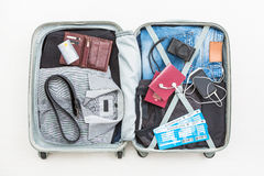 Travel traveler traveling bag top open concepts. Travel traveler traveling bag top open view packing card camera packed credit wallet clothing table leaving Stock Images