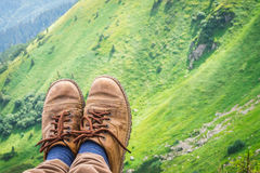 Travel, trekking. Foot traveler in shoes, against the backdrop of mountains. Horizontal frame. Travel, trekking. Foot traveler in shoes, against the backdrop of royalty free stock images