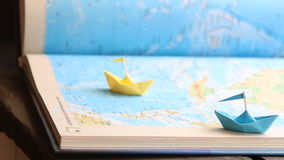 Travel or trip concept. Travel and tourism concept, paper boats on the map stock video footage