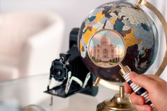 Travel trip to India.  Globe and magnifier. Royalty Free Stock Photos