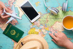Travel. Trip. Vacation - Top view of airplane, camera, passport. And touristic map royalty free stock photos