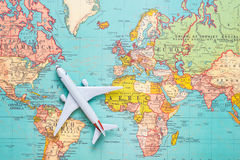 Travel. Trip. Vacation - Top view airplane with touristic map.  Royalty Free Stock Photography