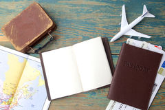 Travel , trip vacation, tourism mockup - close up note book, suitcase, toy airplane and touristic map on wooden table. Stock Photos