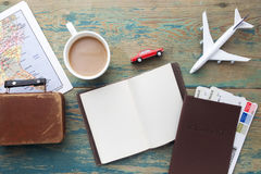 Travel , trip vacation, tourism mockup - close up note book, suitcase, toy airplane and touristic map on wooden table. Royalty Free Stock Photos