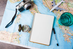 Travel , trip vacation, tourism mockup tools. Travel , trip vacation, tourism mockup - close up of compass, glass of water note pad, pen and toy airplane and Royalty Free Stock Images