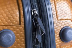 Travel trolley luggage bag. Zipper closeup. Travel trolley luggage bag. Zipper closeup view. Brownish colour Royalty Free Stock Images