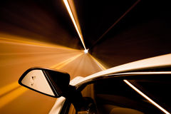 Travel through tunnel motion blur. Car driving through tunnel with motion blur, focus on mirror Royalty Free Stock Photos