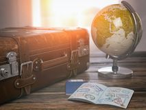 Travel or turism concept.  Old  suitcase  with open passport wit. H visa stamps and globe. 3d illustration Stock Images